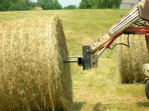 hay bale being speared